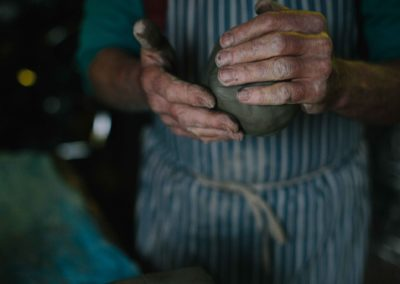 Clive Pearson hands holding clay