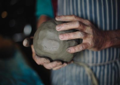 Clive Pearson holding a lump of clay