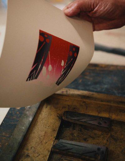 Merlyn Chesterman peeling back an inked print