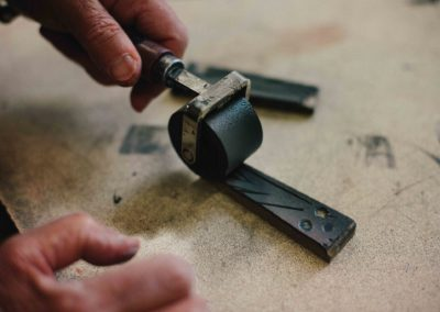 Hand rolling ink onto a wood cut