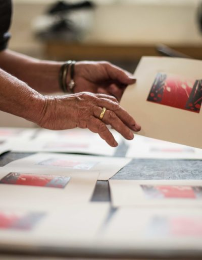 Merlyn Holding a wood cut print