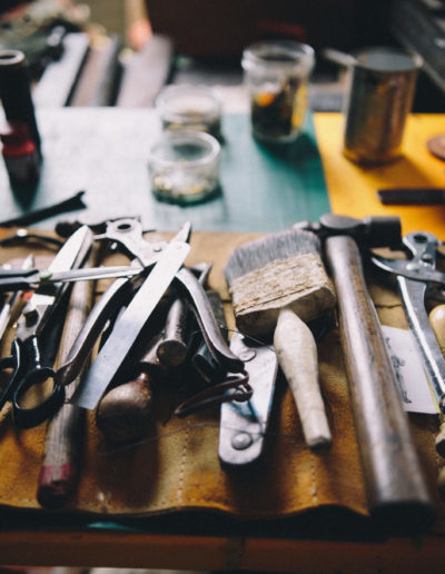 A leather tool kit laid out