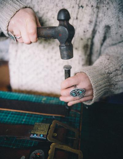 Hammering a leather belt