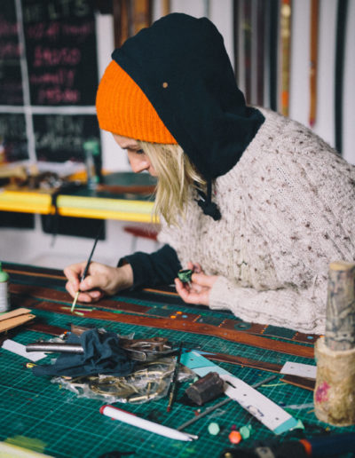 Louise painting a leather belt