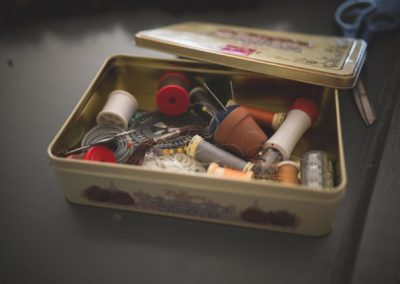 sewing tin with lots of cotton threads