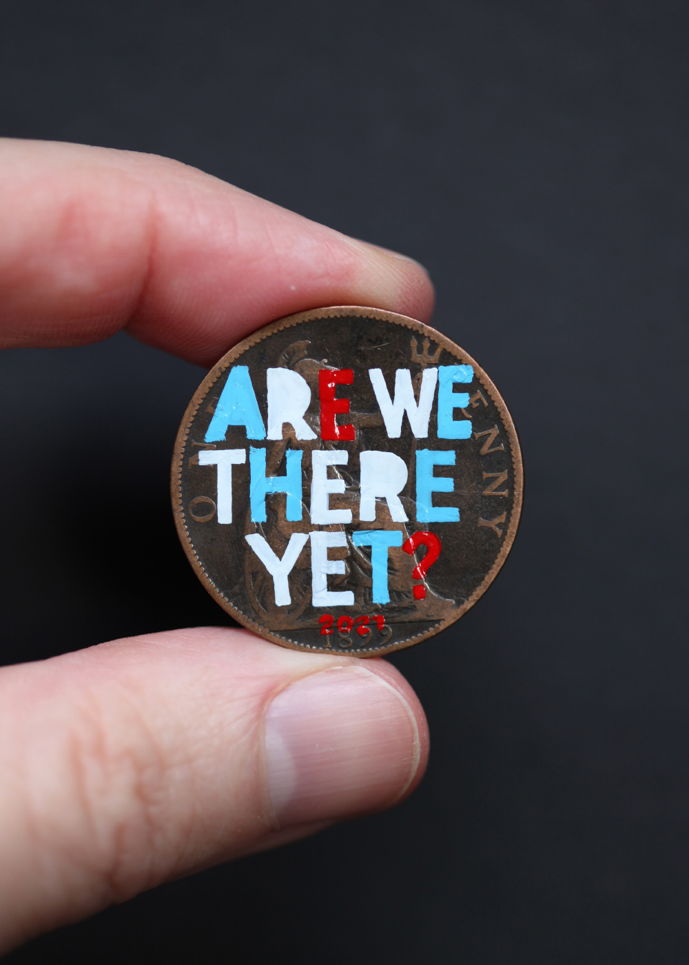 Quiet British Accent Penny art with the words Are we there yet painted on the penny