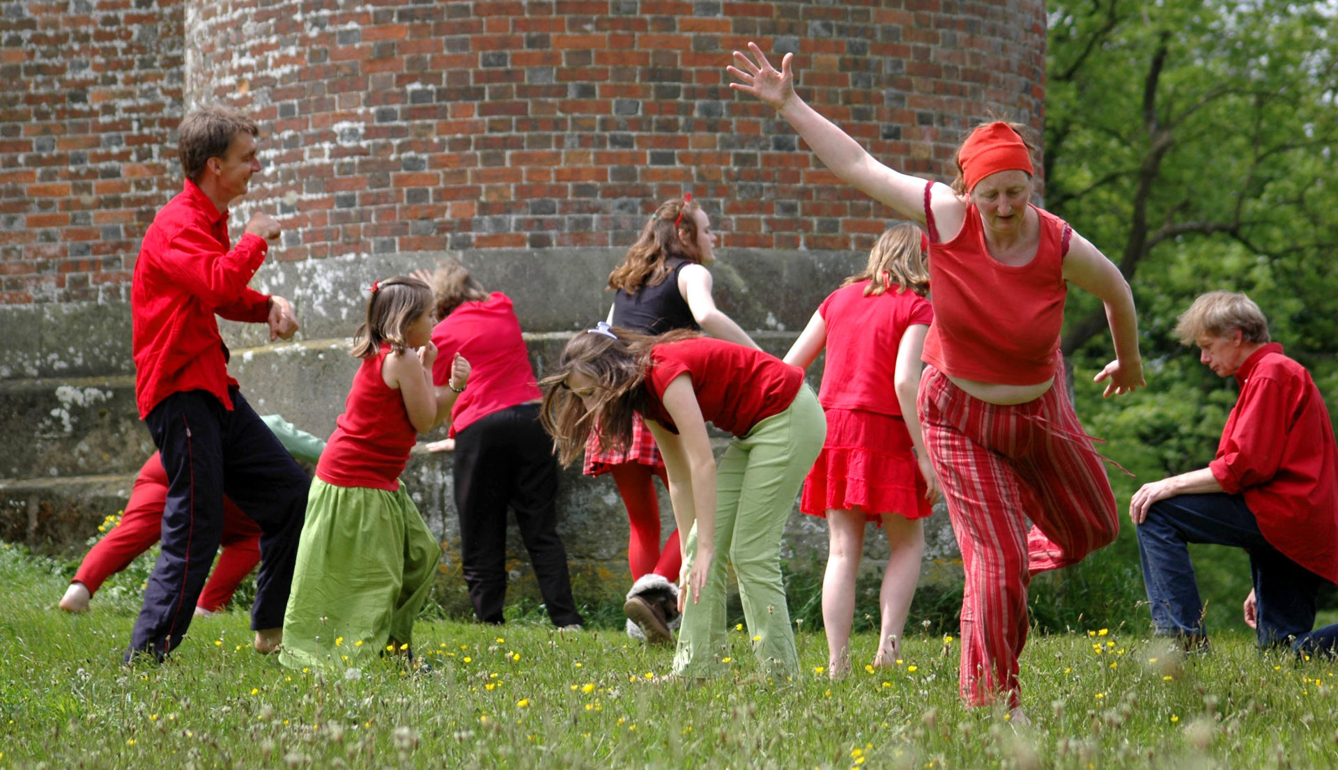 Dancers dressed in red