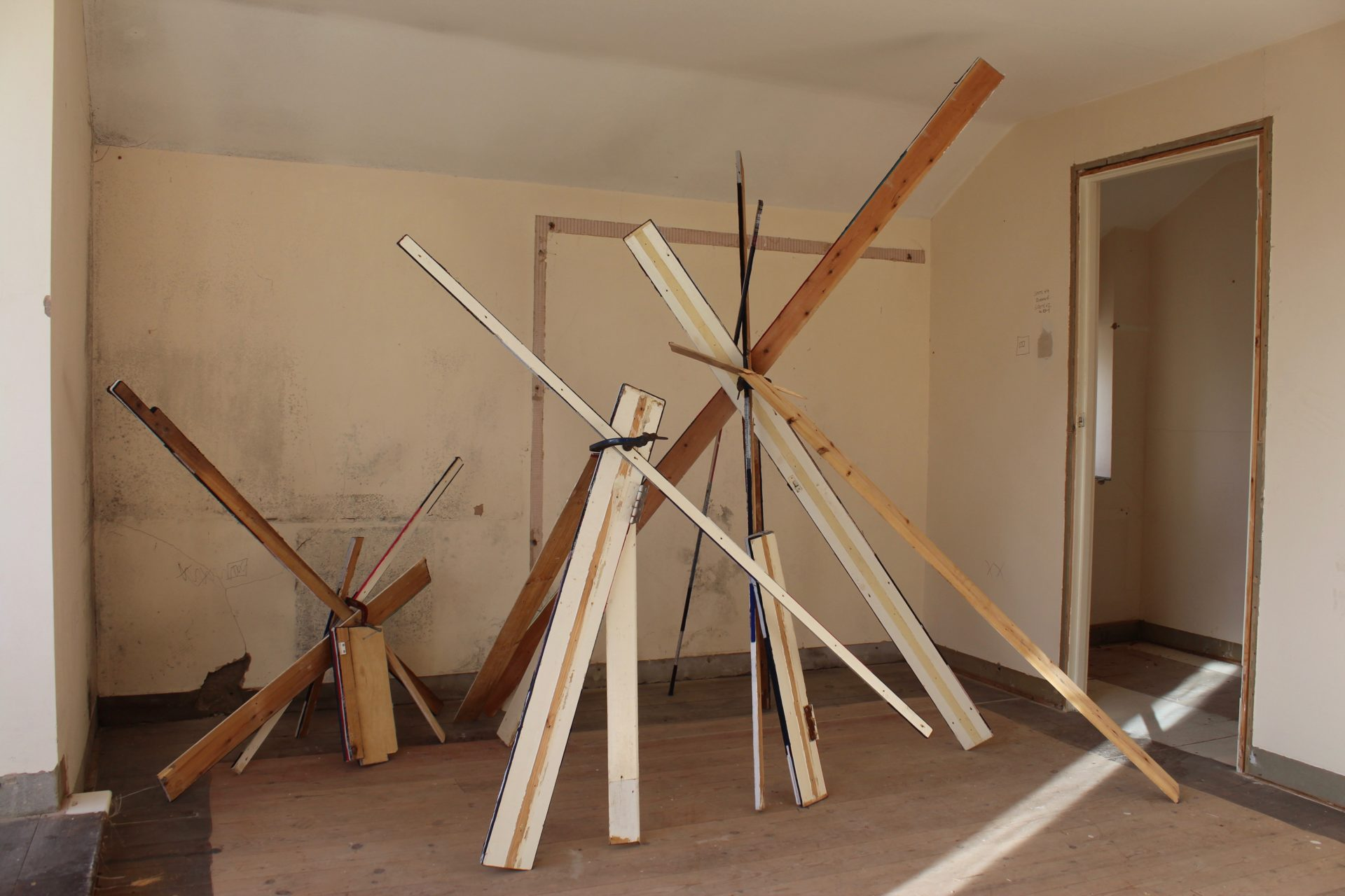 Long planks of wood positioned in a room