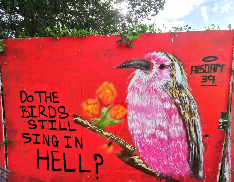A graffiti mural of a bird