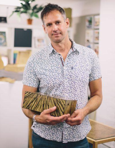 Edward Wild holding a wooden handmade box