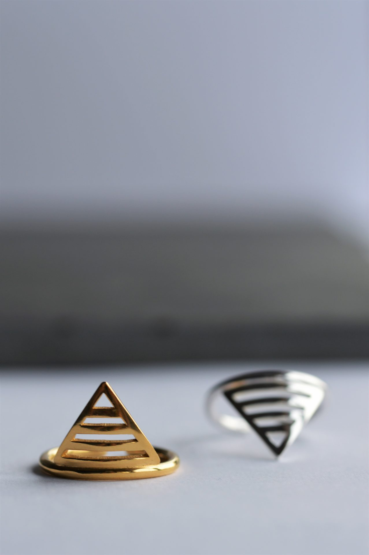 Katherine Barber 1 silver ring and 1 gold ring in the shape of triangles