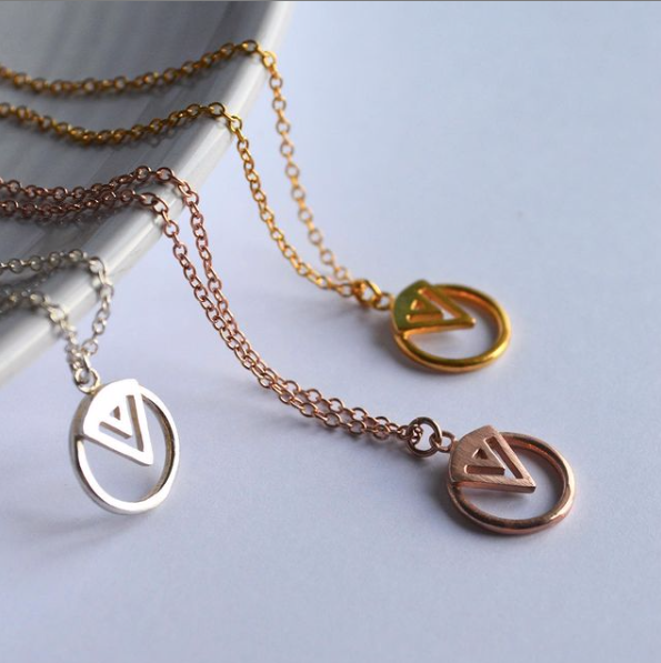 Gold, silver and rose gold pendant necklace