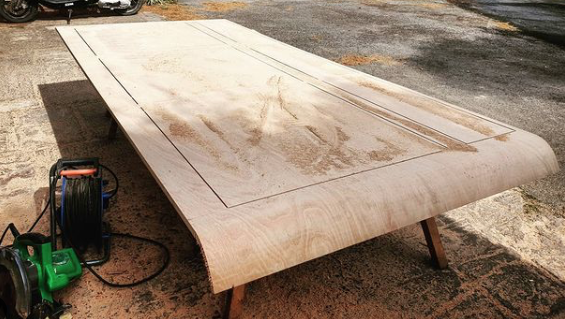 A large handmade wooden table